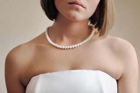 Strand of pearls on young bride