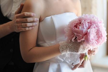 Bride holding beautiful wedding bouquet, focus on bouquet