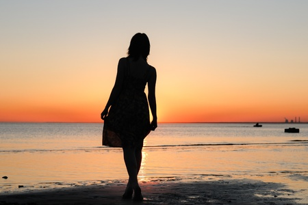 happiness people silhouette on the sunset: Portrait of young woman as silhouette by the sea Stock Photo