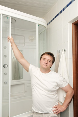 Portrait of courageous man in his bathroom  photo