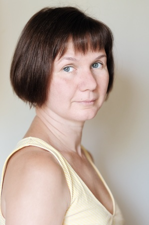 sadece kadınlar: Attractive middle age woman, indoors portrait on white background