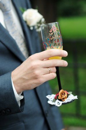 Groom is holding painting wedding champagne glasses Stock Photo - 10503580