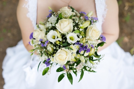 gown: Bride holding beautiful wedding flowers bouquet