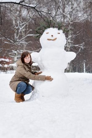 Happy middle age woman having fun in winter