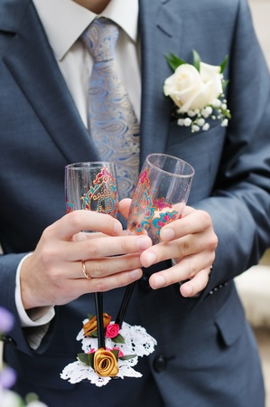 Groom holding painted, wedding champagne glasses  Stock Photo - 12204899