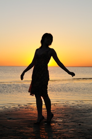 Portrait of young woman as silhouette by the sea  photo