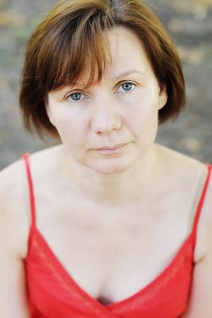 Pensive middle age woman, outdoors portrait  photo