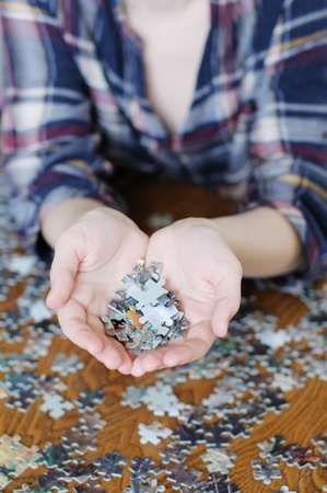Young woman holding pieces of puzzle in her hands  photo