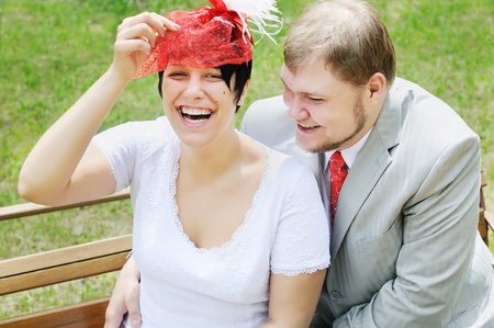 Outdoor portrait of happy bride and groom  photo