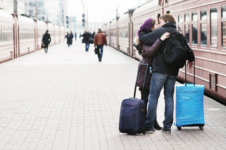 love kiss: Happy young couple on railway station platform
