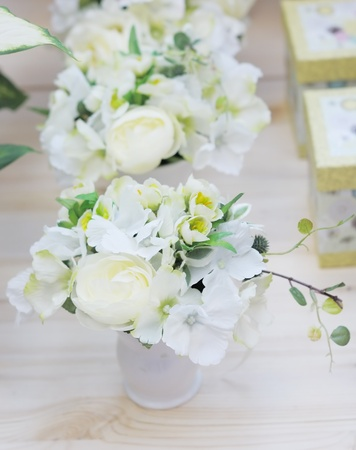 Delicious white and yellow artificial flowers arranged for sale  photo
