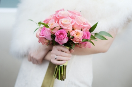 Bride holding beautiful wedding flowers bouquet  photo