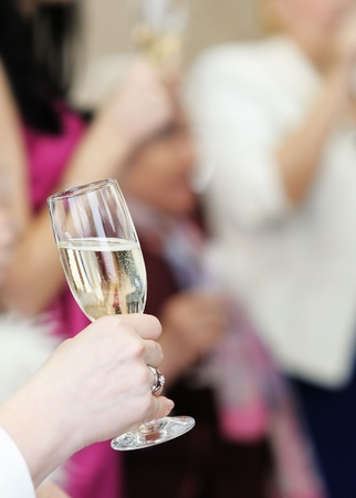 Woman holding glass with champagne