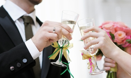 Bride and groom holding champagne glasses Stock Photo - 13354463