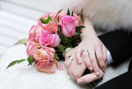 Bride and groom s hands with wedding rings photo