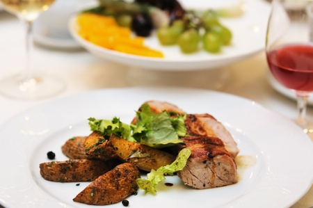 Tasty meat and baked potato on white plate Stock Photo - 13464347