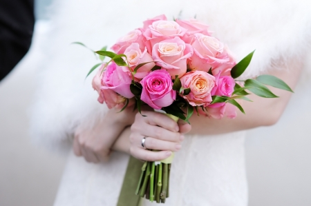 Bride holding beautiful wedding flowers bouquet Stock Photo