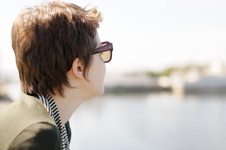 Portrait of adolescence woman with sun glasses photo