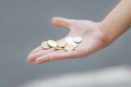 Woman holding golden and silvery coins  shekels  in her hand Stock Photo - 15207412