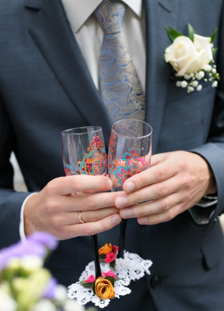 Groom holding painting champagne glasses  Stock Photo - 14988492