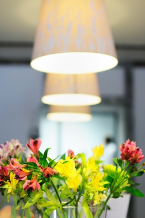 Part of stylish indoor interior with flowers  photo