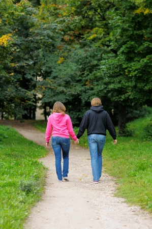 Young couple walking in autumnal park together  photo