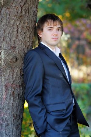 hair tuft: Handsome man  groom , outdoors portrait