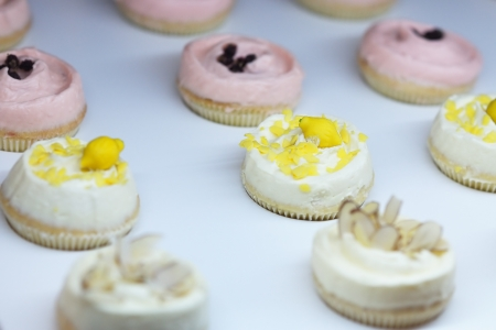Decorated white cream cupcakes in shop photo
