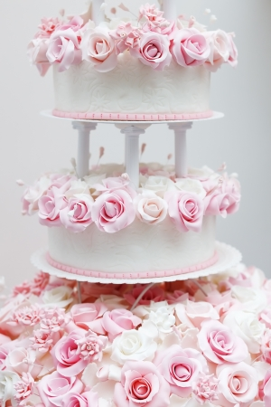 Delicious white wedding cake decorated with pink cream roses Stock Photo - 18802022