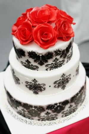 Delicious wedding cake decorated with sugar red roses Stock Photo - 18802018