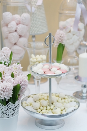 afternoon fancy cake: Delicious wedding sweets  yellow and pink table set  Stock Photo