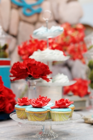 Delicious blue ang red cupcakes Stock Photo - 18937345