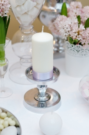 White candle with silk ribbon  detail of table set  Stock Photo - 18937340