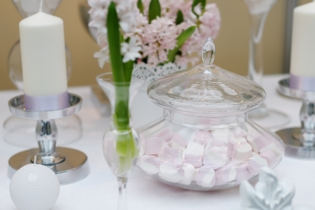 Delicious wedding sweets  yellow and pink table set Stock Photo - 19425217