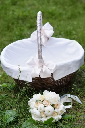 Picnic basket and flowers bouquet photo