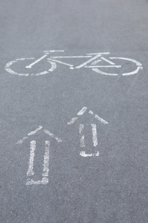 Bicycle road sign and arrows photo