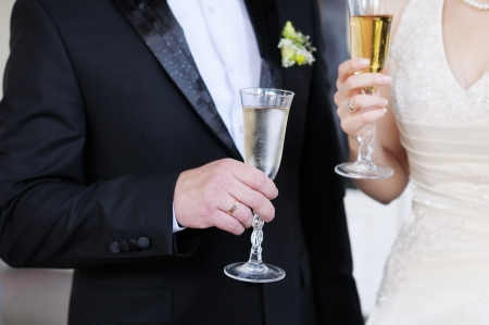Bride and groom holding champagne glasses photo