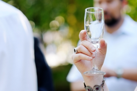 Champagne glass in woman Stock Photo