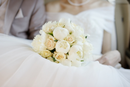 Wedding flowers bouquet on wedding dress