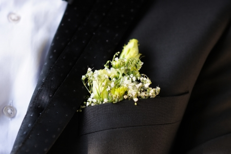 boutonniere: Flowers boutonniere groom close up Stock Photo