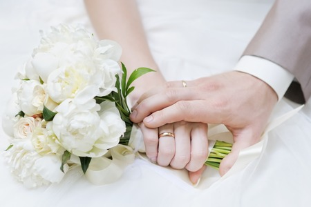 Bride and grooms hands with wedding rings