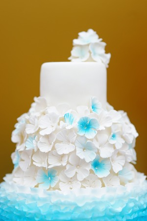 Delicious white and blue wedding cake  photo