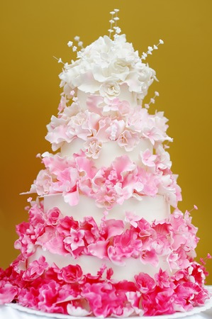 cake stand: Delicious white and pink wedding cake