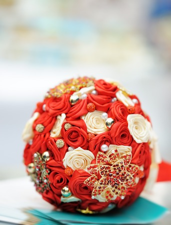 Beautiful red wedding bouquet close up photo