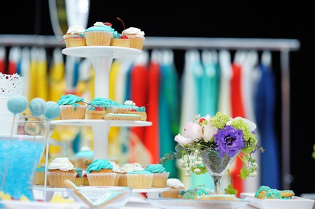 Bright sweet table on wedding or event party photo