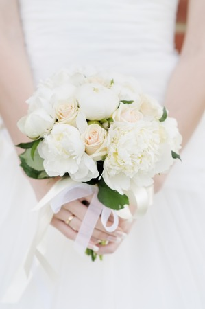 Bride holding wedding flowers bouquet Stock Photo