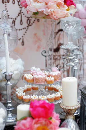 Delicious wedding sweet table with cupcakes  photo