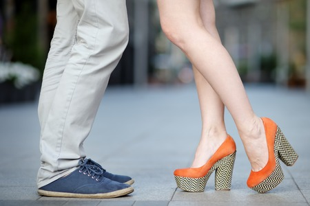 Closeup photo of male and female legs during a date photo