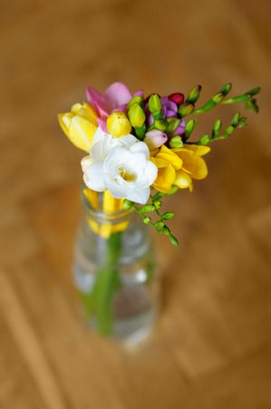 Little flowers bouquet in glass vase  photo