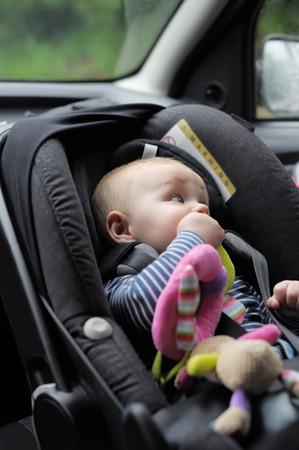 Little baby boy in car seat portrait photo